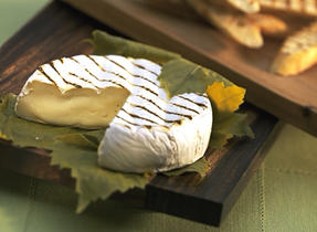 Canadian Brie Wrapped in Grape Leaves with Exotic Grain Salad