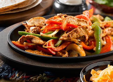 cooking chicken fajitas