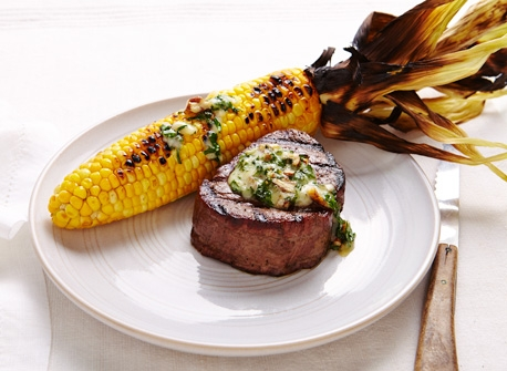 Cheddar-onion butter on steak and corn on the cob Recipe
