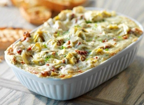 Baked Courtenay Cheddar, Sun Dried Tomato and Artichoke Dip